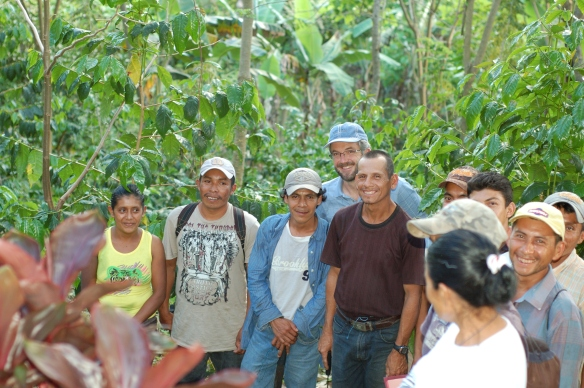 Workers who are part of the Fair Trade committee at a farm in Nicaragua meet with a member of Fair Trade USA's board
