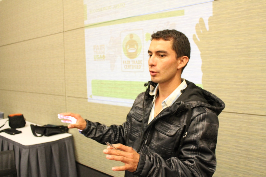 Fabian talks about his community to other Fair Trade farmers and workers at SCAA show in Boston