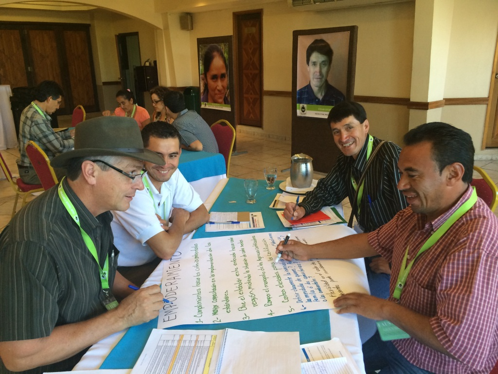 Fair Trade farmers discussing and making recommendations on our empowerment standards: Fabian from Colombia, Cesar from Peru, Faustino from Honduras and Luis from Costa Rica